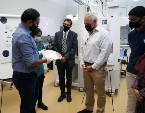 Asif Khan shows President Cabrera a 300 nm FEFET chip that his lab received from Global Foundries. Pictured left to right Khan, Nujhat Tasneem, Douglas Blough, Cabrera, and Prasanna Ravindran